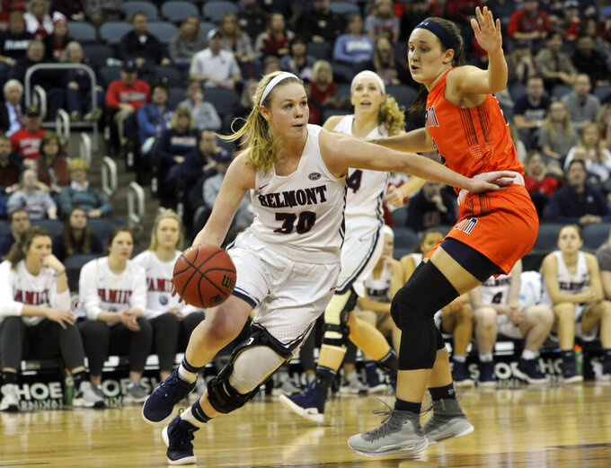 Belmont's Ellie Harmeyer (30) drives the ball past UT Martin's Demi Burdick (33) during the second half of an NCAA college basketball game in the championship of the Ohio Valley Conference basketball tournament, Saturday, March 9, 2019, in Evansville, Ind. (AP Photo/Daniel R. Patmore)