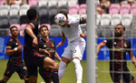Inter Miami defender Leandro Gonzalez Pirez (6) heads the ball as Atlanta United defenders look on during the first half of an MLS soccer match, Sunday, May 9, 2021, in Fort Lauderdale, Fla. (AP Photo/Jim Rassol)