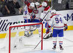 Montreal Canadiens players celebrate after Montreal Canadiens right wing Cole Caufield, second from left, scored against the Vegas Golden Knights during the second period in Game 1 of an NHL hockey Stanley Cup semifinal playoff series Monday, June 14, 2021, in Las Vegas. (AP Photo/John Locher)