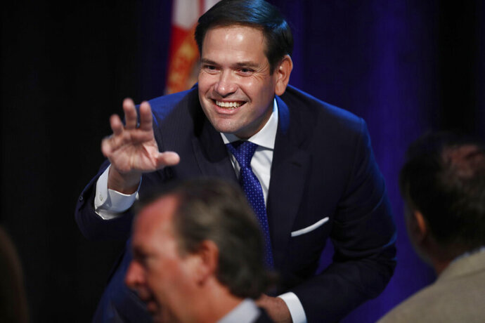 Sen. Marco Rubio, R-Fla., waves before he speaks during a Forum Club meeting on Wednesday, Aug. 21, 2019, in West Palm Beach, Fla. (AP Photo/Brynn Anderson)