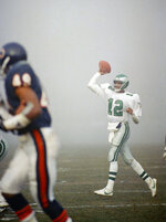FILE - In this Dec. 31, 1988, file photo, Philadelphia Eagles quarterback Randall Cunningham (12) throws a pass against the Chicago Bears at a foggy Soldier Field in Chicago. Chicago's victory in the Fog Bowl 30 years ago is the only time the Bears have defeated the Eagles in three playoff meetings. The Bears get another chance when they host the Eagles in an NFC wild-card game. (AP Photo/Rob Kozloff, File)