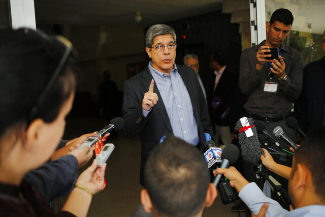 FILE - In this Dec. 12, 2018 file photo, Cuba's Director-General of U.S. Affairs Carlos Fernandez de Cossio makes a statement to reporters, in Havana, Cuba. Cuba's top diplomat in charge of relations with the United States said Thursday, May 21, 2020 that relations have sunk to a new low, and potentially could sink even lower with the appointment of Florida Senator Marco Rubio as Chair of the Senate Intelligence Committee. (AP Photo/Desmond Boylan, File)