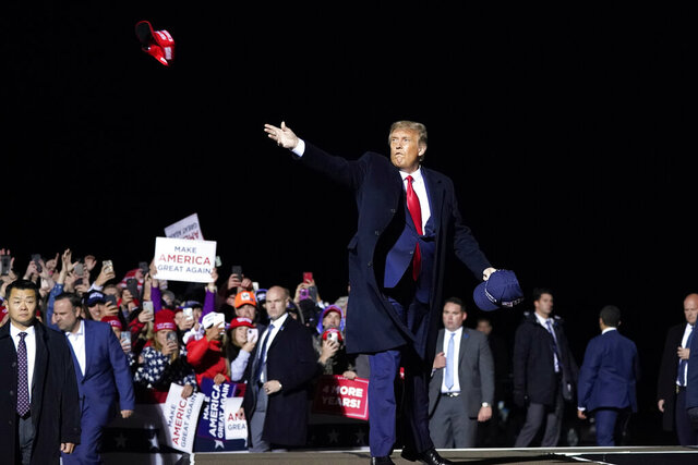 President Donald Trump throws hats to supporters after speaking at a campaign rally at Duluth International Airport, Wednesday, Sept. 30, 2020, in Duluth, Minn. (AP Photo/Alex Brandon)