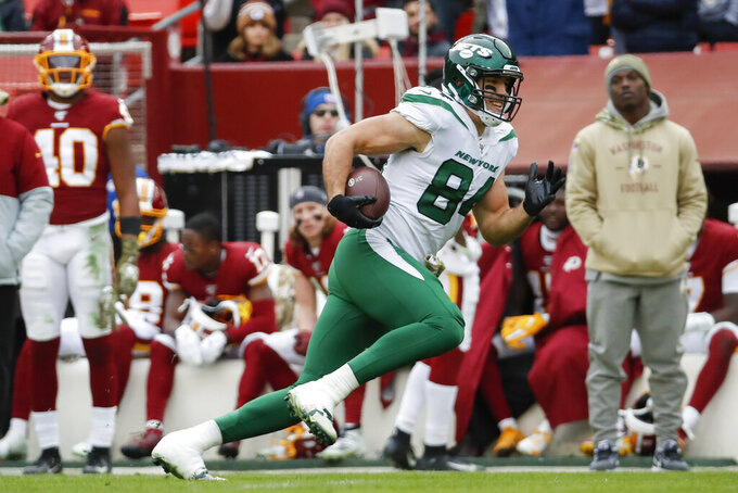 New York Jets tight end Ryan Griffin (84) runs towards the end zone for a touchdown against the Washington Redskins during the first half of an NFL football game, Sunday, Nov. 17, 2019, in Landover, Md. (AP Photo/Alex Brandon)
