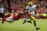 Green Bay Packers quarterback Aaron Rodgers (12) is tackled by Kansas City Chiefs defensive tackle Khalen Saunders (99) during the second half of an NFL football game against the Kansas City Chiefs in Kansas City, Mo., Sunday, Oct. 27, 2019. (AP Photo/Charlie Riedel)
