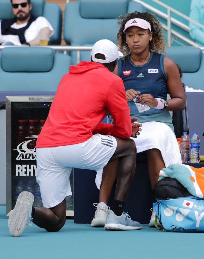 Naomi Osaka, of Japan, talks with her coach Jermaine Jenkins during her match against Hsieh Su-Wei, of Tawain, at the Miami Open tennis tournament, Saturday, March 23, 2019, in Miami Gardens, Fla. (AP Photo/Lynne Sladky)