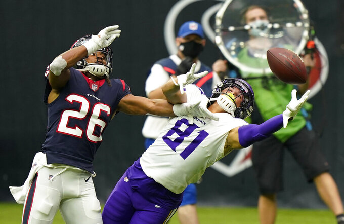 Houston Texans cornerback Vernon Hargreaves III (26) breaks up a pass intended for Minnesota Vikings wide receiver Bisi Johnson (81) during the first half of an NFL football game Sunday, Oct. 4, 2020, in Houston. (AP Photo/David J. Phillip)