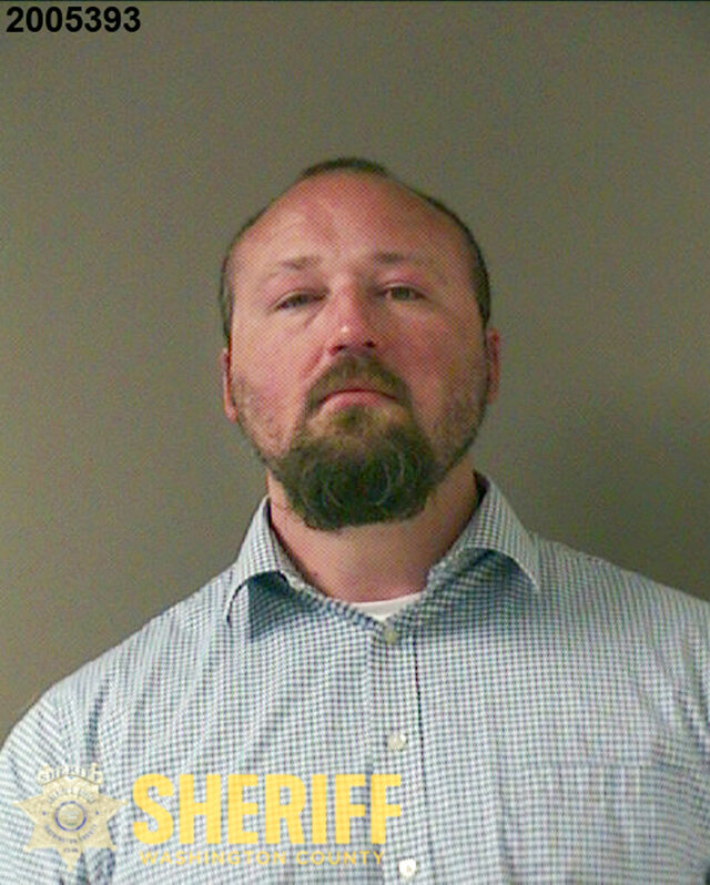 In this undated booking photo released by the Washington County Sheriff's Office is Rian Alden. Alden, a sheriff's deputy in Oregon, was arrested Friday, June 26, 2020, on assault and other charges after a man was slammed into a wall and thrown down in a jail booking area in 2018, fracturing his skull and causing what his lawyer calls a permanent brain injury. (Washington County Sheriff's Office via AP)