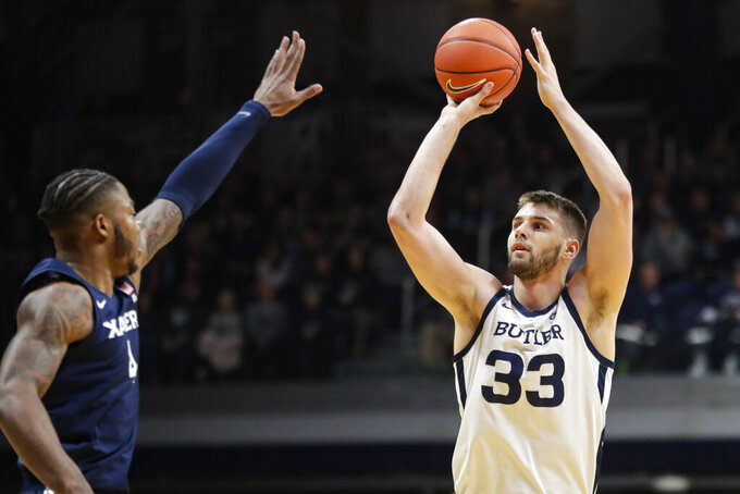Butler forward Bryce Golden (33) shoots over Xavier forward Tyrique Jones (4) in the first half of an NCAA college basketball game in Indianapolis, Wednesday, Feb. 12, 2020. (AP Photo/Michael Conroy)