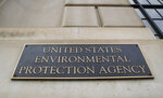 """FILE - In this Sept. 21, 2017, file photo, the Environmental Protection Agency (EPA) Building is shown in Washington. Two high-ranking Trump political appointees at the EPA engaged in fraudulent payroll activities, including payments to employees after they were fired and to one of the officials when he was absent from work, that cost the agency more than $130,000, a report by an internal watchdog says. Former chief of staff Ryan Jackson and former White House liaison Charles Munoz submitted """"official timesheets and personnel forms that contained materially false, fictitious, and fraudulent statements"""" to mislead EPA personnel and facilitate improper payments over multiple months, according to a report by EPA's Office of Inspector General.  (AP Photo/Pablo Martinez Monsivais, File)"""