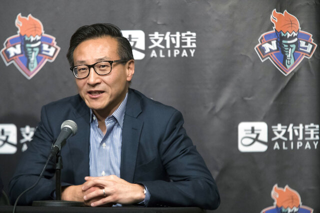 FILE - In this May 9, 2019, file photo, Joe Tsai speaks to reporters during a news conference before a WNBA exhibition basketball game between the New York Liberty and China in New York. Coming from the business world, Liberty owner Tsai did not understand why his franchise did not have a CEO similar to the team's NBA counterpart the Brooklyn Nets. He changed that, promoting Keia Clarke to the position last week, the first CEO in team history.  (AP Photo/Mary Altaffer, File)