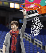Notre Dame head coach Muffet McGraw holds a piece of the net after her team defeated Louisville in an NCAA college basketball game in the championship of the Atlantic Coast Conference women's tournament in Greensboro, N.C., Sunday, March 10, 2019. (AP Photo/Chuck Burton)