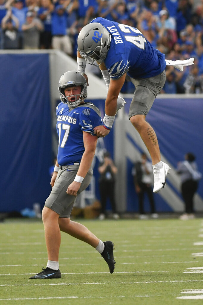 Memphis kicker Joe Doyle (17) celebrates with long snapper Preston Brady (42) after making a field goal in the final minutes of an NCAA college football game against Mississippi State, Saturday, Sept. 18, 2021, in Memphis, Tenn. (AP Photo/John Amis)