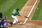 Oakland Athletics' Stephen Piscotty hits a grand slam against the Texas Rangers during the ninth inning of a baseball game in Oakland, Calif., Tuesday, Aug. 4, 2020. The A's won 5-1. (AP Photo/Jed Jacobsohn)