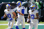 Los Angeles Rams' Robert Woods (17), Jared Goff (16) and Cooper Kupp (10) celebrates after a touchdown by Woods during the first half of an NFL football game against the Philadelphia Eagles, Sunday, Sept. 20, 2020, in Philadelphia. (AP Photo/Chris Szagola)