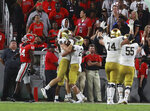 Notre Dame tight end Cole Kmet and teammates celebrate his touchdown reception against Georgia during the first half of an NCAA college football game Saturday, Sept. 21, 2019, in Athens, Ga. (Curtis Compton/Atlanta Journal Constitution via AP)