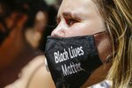 A women wears a protective mask as she joins protesters near Trump Tower as part of a solidarity rally calling for justice over the death of George Floyd, and to highlight police brutality nationwide, Friday, June 12, 2020, in New York. (AP Photo/Frank Franklin II)