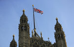 The Union flag flies above Britain's House of Lords, the upper house of the Parliament of the United Kingdom, in London, Thursday, Aug. 29, 2019. British Prime Minister Boris Johnson manoeuvred Wednesday to give his political opponents less time to block a no-deal Brexit split from Europe before the Oct. 31 withdrawal deadline, winning Queen Elizabeth II's approval to suspend Parliament. (AP Photo/Kirsty Wigglesworth)