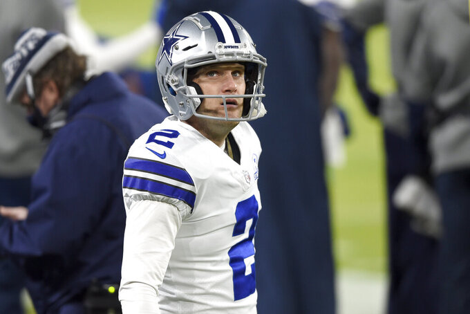 Dallas Cowboys kicker Greg Zuerlein stands on the sideline during the second half of an NFL football game against the Baltimore Ravens, Tuesday, Dec. 8, 2020, in Baltimore. (AP Photo/Gail Burton)