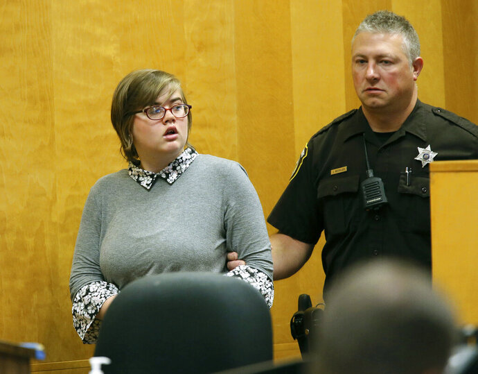 FILE - In this Sept. 29, 2017, file photo, Morgan Geyser, one of two Wisconsin girls charged with stabbing a classmate multiple times in 2014 to impress the fictitious horror character Slender Man, enters a Waukesha County Court for a status hearing in Waukesha, Wis. Geyser, who was 12 at the time of the attack, argued that her case belonged in juvenile court. But on Wednesday, Aug 12, 2020, Wisconsin's 2nd District Court of Appeals denied her appeal. (Michael Sears/Milwaukee Journal-Sentinel via AP, Pool, File)