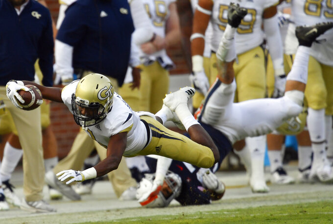 Georgia Tech running back Qua Searcy (1) dives past Virginia linebacker Jordan Mack (37) during the first half of an NCAA football game, Saturday, Nov. 17, 2018, in Atlanta. (AP Photo/Mike Stewart)