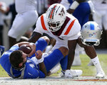 Middle Tennessee quarterback Bailey Hockman (10) loses his helmet while sacked by Virginia Tech defensive back Chamarri Conner (1) in the first half of an NCAA college football game, Saturday, Sept. 11, 2021, in Blacksburg Va. (AP Photo/Matt Gentry)