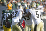 New Orleans Saints middle linebacker Kwon Alexander (5) and strong safety Malcolm Jenkins (27) congratulate free safety Marcus Williams (43) after he intercepted a pass against the Green Bay Packers during the second half of an NFL football game, Sunday, Sept. 12, 2021, in Jacksonville, Fla. (AP Photo/Phelan M. Ebenhack)