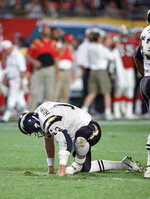 FILE - In this Jan. 29, 1995, file photo, San Diego Chargers quarterback Stan Humphries picks himself up after being injured in the fourth quarter of Super Bowl XXIX against the San Francisco 49ers in Miami. The Chargers only Super Bowl run ended with a 49-26 rout by the 49ers. (AP Photo/Susan Walsh, File)
