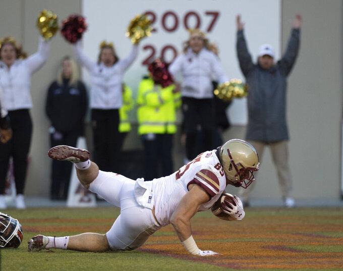 Boston College tight end Korab Idrizi falls into the end zone for a touchdown during an NCAA college football game against Virginia Tech game in Blacksburg, Va., Saturday, Nov. 3, 2018. (AP Photo/Matt Bell)
