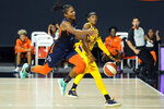 Connecticut Sun forward Alyssa Thomas (25) gets fouled by Los Angeles Sparks guard Brittney Sykes (15) during the second half of a WNBA playoff basketball game Thursday, Sept. 17, 2020, in Bradenton, Fla. (AP Photo/Chris O'Meara)