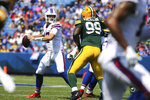 Buffalo Bills quarterback Josh Allen (17) looks to pass while pressured by Green Bay Packers defensive tackle Willington Previlon (99) during the first half of a preseason NFL football game, Saturday, Aug. 28, 2021, in Orchard Park, N.Y. (AP Photo/Jeffrey T. Barnes)