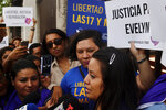Evelyn Beatriz Hernandez, front, walks past protestors supporting her as she arrives at court for a new trial with a new judge after her 30-year sentence for abortion was overturned in February, in Ciudad Delgado, on the outskirts of San Salvador, El Salvador, Monday, July 15, 2019. The young woman who birthed a baby into a toilet in El Salvador faces a second trial for murder Monday, after having already served 33 months, in a case that has drawn international attention because of the country's highly restrictive abortion laws. (AP Photo/Salvador Melendez)