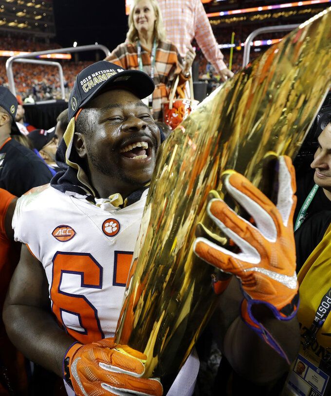 Clemson's Albert Huggins celebrates after the NCAA college football playoff championship game against Alabama, Monday, Jan. 7, 2019, in Santa Clara, Calif. Clemson beat Alabama 44-16. (AP Photo/David J. Phillip)
