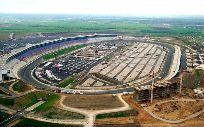 This April 3, 1997, file photo, shows an aerial view of Texas Motor Speedway on its first day of operation in Fort Worth, Texas. IndyCar has gotten the green flag to finally start its season in Texas. The race will be run June 6, 2020, without spectators at Texas Motor Speedway.  (Allison C. Smith/Star-Telegram via AP)