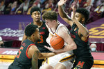 Maryland's Eric Ayala (5) and a teammate double-team Minnesota's Liam Robbins, center, in the first half of an NCAA college basketball game, Saturday, Jan. 23, 2021, in Minneapolis. (AP Photo/Jim Mone)