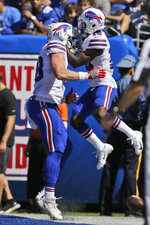 Buffalo Bills' Isaiah McKenzie, right, celebrates his touchdown with Dawson Knox during the first half of an NFL football game against the New York Giants, Sunday, Sept. 15, 2019, in East Rutherford, N.J. (AP Photo/Adam Hunger)