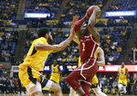 Oklahoma guard Rashard Odomes (1) drives while defended by West Virginia forward Esa Ahmad (23) during the first half of an NCAA college basketball game Saturday, Feb. 2, 2019, in Morgantown, W.Va. (AP Photo/Raymond Thompson)