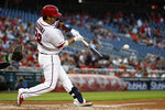 Washington Nationals' Kurt Suzuki hits a two-run home run during the first inning of the team's baseball game against the Baltimore Orioles at Nationals Park on Wednesday, Aug. 28, 2019, in Washington. (AP Photo/Alex Brandon)