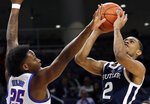 Butler guard Aaron Thompson, right, shoots against DePaul forward Femi Olujobi during the first half of an NCAA college basketball game Wednesday, Jan. 16, 2019, in Chicago. (AP Photo/Nam Y. Huh)