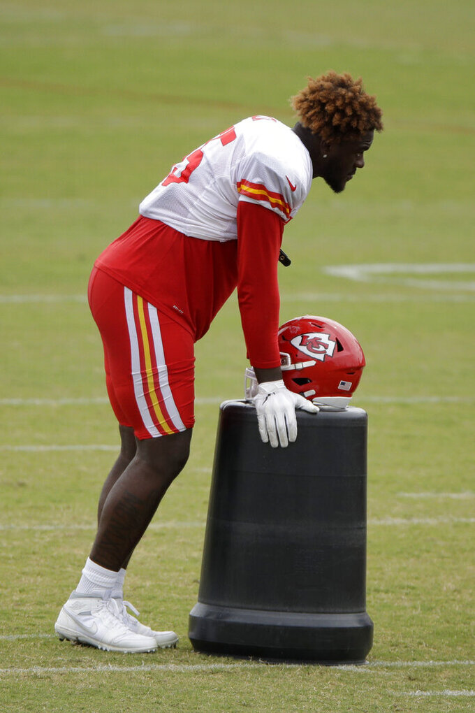 Kansas City Chiefs defensive end Frank Clark listens to instructions during NFL football training camp Friday, Aug. 2, 2019, in St. Joseph, Mo. (AP Photo/Charlie Riedel)