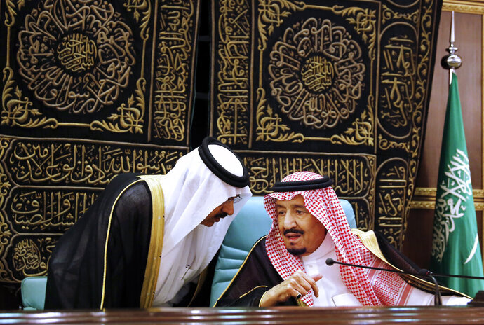 FILE: In this June 1, 2019 file photo, Saudi King Salman chairs the Islamic Summit of the Organization of Islamic Cooperation (OIC) in Mecca, Saudi Arabia. May 31 and June 1 Salman hosts three high-level summits in Mecca, drawing heads of state from across the Middle East and Muslim countries to present a unified Muslim and Arab position on Iran. The monarch called on the international community to use all means to confront Iran and accuses the Shiite power of being behind