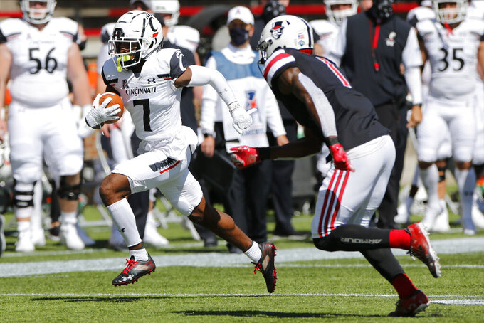 Cincinnati wide receiver Tre Tucker, left, cuts upfield against Austin Peay defensive back Kam Ruffin during the first half of an NCAA college football game Saturday, Sept. 19, 2020, in Cincinnati, Ohio. (AP Photo/Jay LaPrete)
