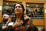 FILE - In this Feb. 27, 2019, file photo, Dolores Huerta, the Mexican-American social activist who formed a farmworkers union with Cesar Chavez, stands for the Pledge of Allegiance in Spanish while visiting the New Mexico Statehouse in Santa Fe, N.M. In an essay, Associated Press writer Russell Contreras says the July Fourth holiday as a Mexican American has always troubled him because of his family's history in the U.S. But his photo of Huerta standing for the Pledge of Allegiance on his birthday is one of the things that makes him re-imagine the holiday. (AP Photo/Russell Contreras, File)