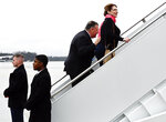 Secretary of State Mike Pompeo, center, boards a plane with his wife Susan, for a multi-country trip, Thursday, Feb. 13, 2020, at Andrews Air Force Base, Md. (Andrew Caballero-Reynolds/Pool via AP)
