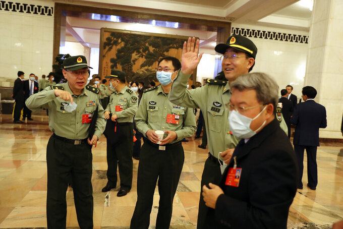 Military delegates gather before the opening session of China's National People's Congress (NPC) at the Great Hall of the People in Beijing, Friday, May 22, 2020. (AP Photo/Ng Han Guan, Pool)