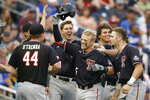 Texas Tech's Brian Klein, third from right, celebrates his solo home run against Florida State in the sixth inning of an NCAA College World Series baseball game in Omaha, Neb., Wednesday, June 19, 2019. (AP Photo/Nati Harnik)