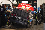 Crew members work on William Byron's car after he wrecked in the second of two qualifying auto races for the NASCAR Daytona 500 at Daytona International Speedway, early Friday, Feb. 12, 2021, in Daytona Beach, Fla. (AP Photo/John Raoux)