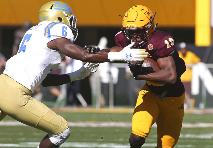 Arizona State wide receiver Kyle Williams, right, fends off the tackle of UCLA safety Adarius Pickett, left, after a catch during the first half of an NCAA college football game, Saturday, Nov. 10, 2018, in Tempe, Ariz. (AP Photo/Ralph Freso)