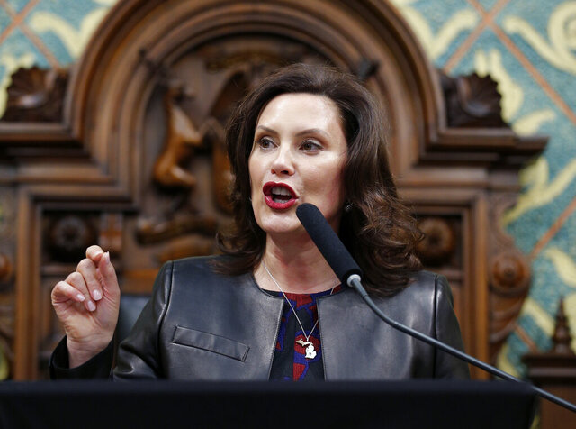 FILE - In this Jan. 29, 2020, file photo Michigan Gov. Gretchen Whitmer delivers her State of the State address to a joint session of the House and Senate at the state Capitol in Lansing, Mich. Across an arc of vital swing states, the coronavirus has put politics on an uneasy pause. The tension is most pronounced in Michigan, where the outbreak is far worse than in any of the other northern political battlegrounds. (AP Photo/Al Goldis, File)