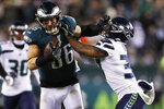 Philadelphia Eagles' Zach Ertz, left, tries to hold off Seattle Seahawks' Quandre Diggs during the second half of an NFL wild-card playoff football game, Sunday, Jan. 5, 2020, in Philadelphia. (AP Photo/Julio Cortez)